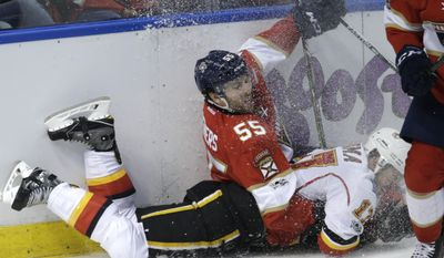 Florida Panthers defenseman Jason Demers (55) and Calgary Flames center Lance Bouma (17) fall to the ice during the second period of an NHL hockey game, Friday, Feb. 24, 2017, in Sunrise, Fla. (AP Photo/Lynne Sladky)