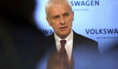 The CEO of Volkswagen Matthias Mueller speaks during a press conference held after the conclusion of the company's board of directors meeting in Wolfsburg, Germany, Friday, Feb. 24, 2017. Volkswagen bounced back into the black in 2016 after suffering a loss the previous year due to the diesel emissions scandal, according to figures released by the German automaker Friday. (Swen Pf'rtner/dpa via AP)