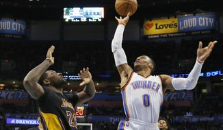 Oklahoma City Thunder guard Russell Westbrook (0) shoots in front of Los Angeles Lakers center Tarik Black during the second quarter of an NBA basketball game in Oklahoma City, Friday, Feb. 24, 2017. (AP Photo/Sue Ogrocki)