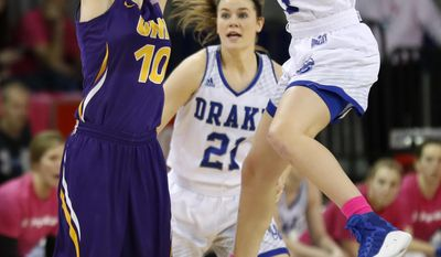 Northern Iowa guard Ellie Herzberg, left, passes over Drake's Nicole Miller, right, and Sammie Bachrodt (21) during the first half of an NCAA college basketball game, Friday, Feb. 24, 2017, in Des Moines, Iowa. (AP Photo/Charlie Neibergall)