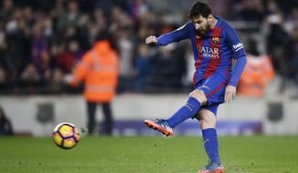 FC Barcelona's Lionel Messi kicks the ball to score a penalty during the Spanish La Liga soccer match between FC Barcelona and Leganes at the Camp Nou stadium in Barcelona, Spain, Sunday, Feb. 19, 2017. (AP Photo/Manu Fernandez)
