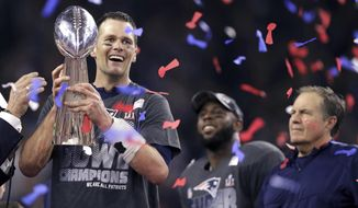 FILE - In this Feb. 5, 2017, file photo, New England Patriots' Tom Brady holds the Vince Lombardi Trophy beside coach Bill Belichick, right, after the Patriots defeated the Atlanta Falcons 34-28 in overtime at the NFL Super Bowl 51 football game in Houston.  A new book and a movie are in the works about Brady and the suspension he overcame to earn an unprecedented fifth Super Bowl ring. (AP Photo/Darron Cummings, File)