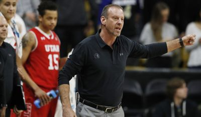 Utah coach Larry Krystkowiak talks to his team during the first half of an NCAA college basketball game against Colorado on Thursday, Feb. 23, 2017, in Boulder, Colo. (AP Photo/David Zalubowski)