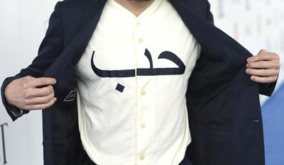 """Casey Affleck displays his shirt with the Arabic word """"love"""" as he arrives at the Film Independent Spirit Awards on Saturday, Feb. 25, 2017, in Santa Monica, Calif. (Photo by Jordan Strauss/Invision/AP)"""