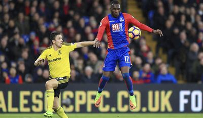 Middlesbrough's Stewart Downing, left, and Crystal Palace's Christian Benteke battle for the ball during the Premier League soccer match between Crystal Palace and Middlesbrough at Selhurst Park, London, England. Saturday, Feb. 25, 2017 (John Walton/PA via AP)
