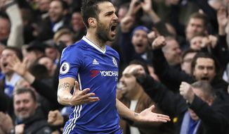 Chelsea's Cesc Fabregas celebrates after he scored a goal during the English Premier League soccer match between Chelsea and Swansea City at Stamford Bridge stadium in London, Saturday, Feb. 25, 2017. (AP Photo/Kirsty Wigglesworth)