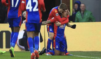 Crystal Palace's Patrick Van Aanholt celebrates scoring his side's first goal of the game with team mates during the Premier League soccer match between Crystal Palace and Middlesbrough at Selhurst Park, London, England. Saturday, Feb. 25, 2017 (John Walton/PA via AP)
