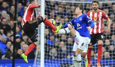 Sunderland's Bryan Oviedo, left, and Everton's Ross Barkley battle for the ball during the English Premier League soccer match between Everton and Sunderland at Goodison Park, Liverpool, England. Saturday, Feb. 25, 2017.(Peter Byrne/PA via AP)
