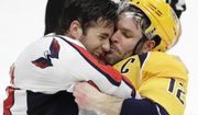 Washington Capitals right wing Tom Wilson, left, and Nashville Predators center Mike Fisher fight during the third period of an NHL hockey game Saturday, Feb. 25, 2017, in Nashville, Tenn. (AP Photo/Mark Humphrey)