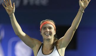 Elina Svitolina of Ukraine celebrates after she defeated Caroline Wozniacki of Denmark in the final match of the Dubai Tennis Championships in Dubai, United Arab Emirates, Saturday, Feb. 25, 2017. (AP Photo/Kamran Jebreili)