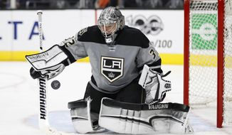 Los Angeles Kings goalie Jonathan Quick defects a puck during the third period of an NHL hockey game against the Anaheim Ducks Saturday, Feb. 25, 2017, in Los Angeles. The Kings won 4-1. (AP Photo/Jae C. Hong)