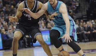 Sacramento Kings forward Skal Labissiere, left, guards Charlotte Hornets forward Frank Kaminsky during the first half of an NBA basketball game Saturday, Feb. 25, 2017, in Sacramento, Calif. (AP Photo/Rich Pedroncelli)