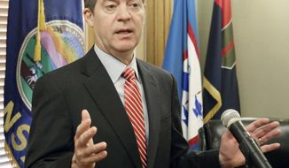 FILE - In this Feb. 22, 2017 file photo, Gov. Sam Brownback takes questions from the media after signing the veto of the tax bill sent to him from the legislature in Topeka, Kan.  Debates in the Kansas Legislature over taxes, expanding the state's Medicaid program and restoring guaranteed tenure for public school teachers illustrate how much clout  Brownback and his allies have lost. (Thad Allton /The Topeka Capital-Journal via AP)