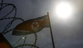 A North Korean flag waves at North Korean Embassy in Kuala Lumpur, Malaysia, Saturday, Feb. 25, 2017. According to police Friday, forensics stated that the banned chemical weapon VX nerve agent was used to kill Kim Jong Nam, the North Korean ruler's outcast half brother who was poisoned last week at the airport. (AP Photo/Daniel Chan)