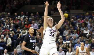 Connecticut's Katie Lou Samuelson scores during the first half of an NCAA basketball game against Memphis in Storrs, Conn., on Saturday, Feb. 25, 2017. (AP Photo/Fred Beckham)