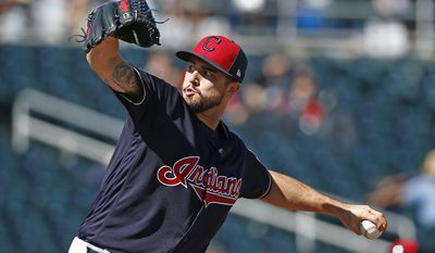 Cleveland Indians pitcher Ryan Merritt throws against the Cincinnati Reds during the second inning of a spring training baseball game Saturday, Feb. 25, 2017, in Goodyear, Ariz. (AP Photo/Ross D. Franklin)