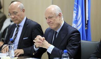 UN Special Envoy for Syria Staffan de Mistura, right, attends a meeting of Intra-Syria peace talks with Syrian government delegation at Palais des Nations in Geneva, Switzerland, Saturday, Feb. 25, 2017. (Pierre Albouy/Pool Photo via AP)