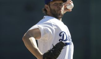 Los Angeles Dodgers' Clayton Kershaw warms up before a spring training baseball game against the Chicago White Sox Saturday, Feb. 25, 2017, in Glendale, Ariz. (AP Photo/Morry Gash)