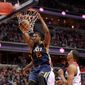 Utah Jazz forward Derrick Favors dunks against Washington Wizards forward Otto Porter Jr. during the second half on Sunday. The Wizards were outmuscled from the start in a 102-92 defeat that produced the team's first losing streak since Jan. 2 and Jan. 3, when they lost back-to-back games. (Associated Press)