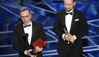 """Kevin O'Connell, left, and Andy Wright accept the award for best sound mixing for """"Hacksaw Ridge"""" at the Oscars on Sunday, Feb. 26, 2017, at the Dolby Theatre in Los Angeles. (Photo by Chris Pizzello/Invision/AP)"""