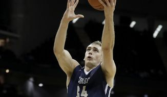 George Washington's Tyler Cavanaugh gets past UAB's William Lee for a shot during the first half of an NCAA college basketball game Tuesday, Nov. 22, 2016, in Kansas City, Mo. (AP Photo/Charlie Riedel) **FILE**