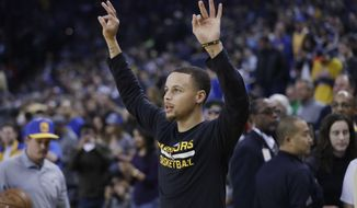 Golden State Warriors' Stephen Curry warms up before an NBA basketball game against the Brooklyn Nets Saturday, Feb. 25, 2017, in Oakland, Calif. (AP Photo/Marcio Jose Sanchez)
