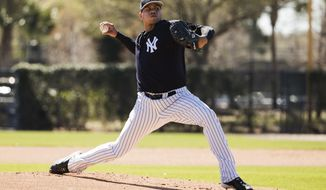New York Yankees pitcher Dellin Betances pitches ahead of a spring training baseball game against the Toronto Blue Jays on Sunday, Feb. 26, 2017, in Tampa, Fla. (AP Photo/Matt Rourke)