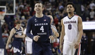 BYU guard Nick Emery (4) smiles near the end of the second half of the team's NCAA college basketball game against Gonzaga in Spokane, Wash., Saturday, Feb. 25, 2017. BYU won 79-71. (AP Photo/Young Kwak)