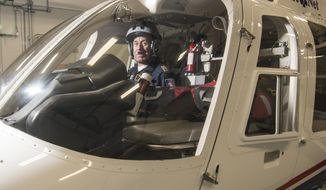 ADVANCE FOR SUNDAY, FEB. 26, 2017 - In this Tuesday, Feb. 14, 2017 photo, pilot John Linke sits in a helicopter in Norfolk, Neb. Lifenet is retiring after 50 years of flying. (Jake Wragge /The Norfolk Daily News via AP)