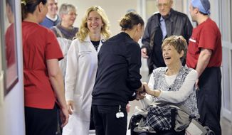 ADVANCE FOR SUNDAY, FEB. 26, 2017 - In this Feb. 13, 2017 photo, JoAnn York greets Registered Nurse Breanna Kaskie as she revisits the Cardiovascular Intensive Care Unit on Bryan East Campus in Lincoln, Neb., for the first time since being released from there following a 143-day stay. Eric Gregory/The Journal-Star via AP)