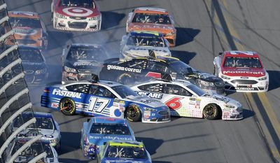 Ricky Stenhouse Jr. (17), Trevor Bayne (6) and Elliott Sadler (7) collide along the front stretch after coming out of Turn 4 during the NASCAR Daytona 500 auto race at Daytona International Speedway, Sunday, Feb. 26, 2017, in Daytona Beach, Fla. (AP Photo/Phelan M. Ebenhack)