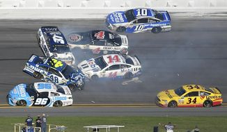 Jimmie Johnson (48), Clint Bowyer (14), Chris Buescher (37), Kevin Harvick (4), D.J. Kennington (96) and Danica Patrick (10) collide in a multi-car wreck between Turns 3 and 4, as Landon Cassill (34) drives past, during the NASCAR Daytona 500 auto race at Daytona International Speedway, Sunday, Feb. 26, 2017, in Daytona Beach, Fla. (AP Photo/Phelan M. Ebenhack)