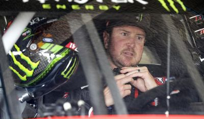 FILE - In this Feb. 18, 2017, file photo, Kurt Busch sits behind the wheel as he prepares for NASCAR auto racing practice at Daytona International Speedway in Daytona Beach, Fla. Monster Energy is set to start a two-year sponsorship deal with a two-year option worth a reported $20 million annually _ a staggering discount from the $750 million, 10-year deal Sprint had paid NASCAR to have its name emblazoned in the title series. (AP Photo/Terry Renna, File)