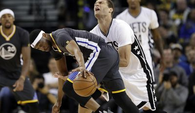 Golden State Warriors' Ian Clark, left, strips the ball from Brooklyn Nets' Brook Lopez during the first half of an NBA basketball game Saturday, Feb. 25, 2017, in Oakland, Calif. (AP Photo/Marcio Jose Sanchez)