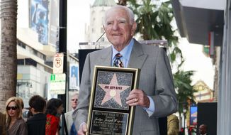 """In this Thursday, Nov. 12, 2009, file photo, Judge Joseph Wapner is honored with star on the Hollywood Walk of Fame in Los Angeles. Wapner, who presided over """"The People's Court"""" with steady force during the heyday of the reality courtroom show, has died. Wapner died at home in his sleep Sunday, Feb. 26, 2017, according to his son, David Wapner. (AP Photo/Damian Dovarganes)"""
