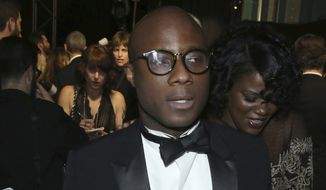 """Barry Jenkins, winner of the award for best picture for """"Moonlight"""", appears backstage at the Oscars on Sunday, Feb. 26, 2017, at the Dolby Theatre in Los Angeles. (Photo by Matt Sayles/Invision/AP)"""