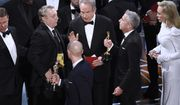 "Warren Beatty, center, discusses the results of the award for best picture with Academy of Motion Pictures Arts and Sciences officials and producers from ""La La Land"" at the Oscars on Sunday, Feb. 26, 2017, at the Dolby Theatre in Los Angeles. (Photo by Chris Pizzello/Invision/AP)"