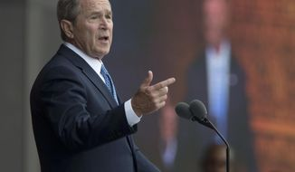 """FILE - In this Sept. 24, 2016 file photo, former President George W. Bush speaks in Washington. Bush said Monday, Feb. 27, 2017, """"we all need answers"""" on the extent of contact between President Donald Trump's team and the Russian government, and he defended the media's role in keeping world leaders in check. (AP Photo/Manuel Balce Ceneta, File)"""