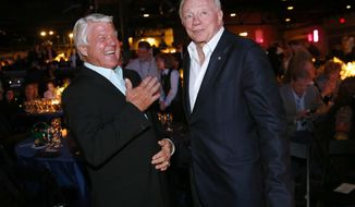 Dallas Cowboys owner Jerry Jones, right, and his former Super Bowl-winning coach Jimmy Johnson laugh following the 25th Anniversary of Super Bowl XXVII at Gilley's in Dallas, Saturday, Feb. 25, 2017. (Tom Fox/The Dallas Morning News via AP)