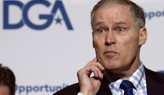 Democratic Governors Association (DGA) Vice Chairman Jay Inslee of Wash., listens to a reporter's question during a news confernce following a DGA meeting at the National Governors Association Winter Meeting in Washington, Saturday, Feb. 25, 2017. (AP Photo/Cliff Owen)