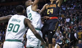 Atlanta Hawks forward Kent Bazemore (24) drive to the basket against the Boston Celtics during the first quarter of an NBA basketball game in Boston, Monday, Feb. 27, 2017. (AP Photo/Charles Krupa)