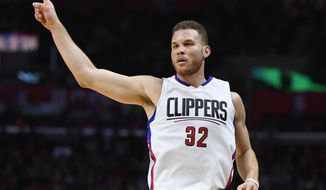 Los Angeles Clippers forward Blake Griffin gestures after hitting a three-point shot during the first half of an NBA basketball game against the Charlotte Hornets, Sunday, Feb. 26, 2017, in Los Angeles. (AP Photo/Mark J. Terrill)