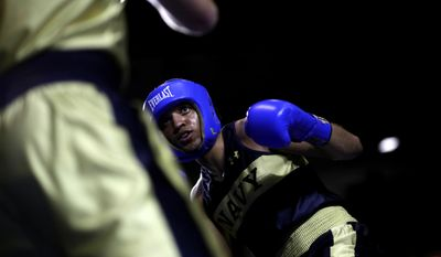 In this Feb. 24, 2017 photo, Midshipman Jordan Davis, of Pensacola, Fla., competes with Peter Ventola of Boston in a 175-lb boxing match during the U.S. Naval Academy's Brigade Boxing Championships in Annapolis, Md. (AP Photo/Patrick Semansky)