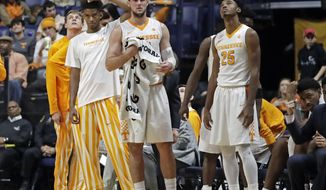 FILE - In this Dec. 18, 2016, file photo, Tennessee players watch from the bench late in the second half of an 86-76 loss to Gonzaga in an NCAA college basketball game in Nashville, Tenn. Tennessee played well enough for much of the season to have legitimate NCAA Tournament hopes but now a more realistic goal is to stay above .500. (AP Photo/Mark Humphrey, File)