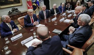 President Donald Trump, left, and Vice President Mike Pence, right, participate in a meeting with health insurance company executives in the Roosevelt Room of the White House in Washington, Monday, Feb. 27, 2017. (AP Photo/Pablo Martinez Monsivais)