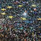 Protesters on Sunday lighted the flashes of their mobile phones in the colors of the European Union flag outside the Romanian government headquarters. (Associated Press photographs)
