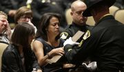 Susan Oliver, center, the wife of slain Sacramento County Deputy Danny Oliver, is presented flag during a memorial service in Roseville, Calif. Monday, Nov. 3, 2014.  Oliver and Placer County Sheriff's Detective Michael Davis Jr. were shot and killed in a shooting spree that spanned two Northern California counties, Oct. 26.   Luis Enrique Monroy-Bracamonte, who was booked into the Sacramento County jail under the pseudonym Marcelo Marquez, faces murder charges in the killing of the two deputies, and the wounding of another deputy and a bystander.Susan Oliver, center, the wife of slain Sacramento County Deputy Danny Oliver, is presented flag during a memorial service in Roseville, Calif. Monday, Nov. 3, 2014.  Oliver and Placer County Sheriff's Detective Michael Davis Jr. were shot and killed in a shooting spree that spanned two Northern California counties, Oct. 26.   Luis Enrique Monroy-Bracamonte, who was booked into the Sacramento County jail under the pseudonym Marcelo Marquez, faces murder charges in the killing of the two deputies, and the wounding of another deputy and a bystander.(AP Photo/Rich Pedroncelli)