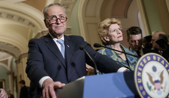 Senate Minority Leader Chuck Schumer, D-N.Y., with Sen. Debbie Stabenow, D-Mich., right, meets with reporters on Capitol Hill before President Donald Trump's speech to the nation, in Washington, Tuesday, Feb. 28, 2017.  (AP Photo/J. Scott Applewhite)