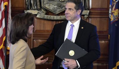New York Lt. Gov. Kathy Hochul, left, speaks with Gov. Andrew Cuomo after a cabinet meeting in the Red Room at the Capitol on Tuesday, Feb. 28, 2017 in Albany, N.Y. (AP Photo/Hans Pennink)