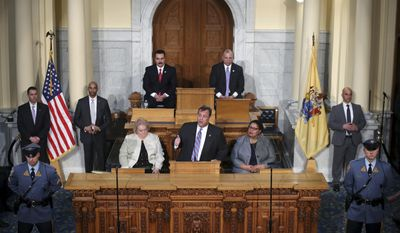 New Jersey Gov. Chris Christie, center, stands in front of Vincent Prieto, left, Speaker of the New Jersey General Assembly and Steve Sweeney, right, New Jersey Senate President, in the Assembly chamber of the Statehouse as he delivers his final budget address Tuesday, Feb. 28, 2017, in Trenton, N.J. (AP Photo/Mel Evans)